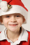 Child with Santa Claus hat Royalty Free Stock Images