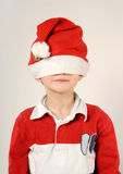 Child with Santa Claus hat Stock Photography