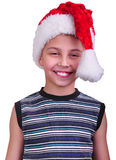 Child with Santa Claus red hat stock photo