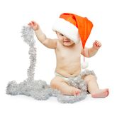 Child in Santa Claus red hat and tinsel Royalty Free Stock Photography