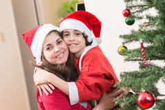 Child in Santa clothes enjoying Christmas at home Stock Photography