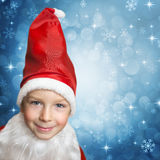 Child in santa clothes Stock Images