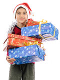 Child in Santa costume full of present boxes Stock Photo