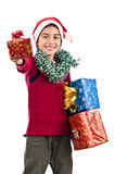 Child in Santa costume giving present at Christmas Royalty Free Stock Photography