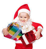 Child in santa costume holding group gift box. Stock Photos