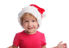 Child in santa hat Stock Image