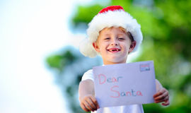 Child with santa hat Stock Photo