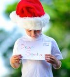Child with santa hat Stock Image