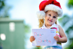 Child with santa hat Stock Photo