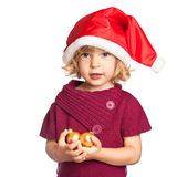 Child in Santa hat with balls Stock Photos