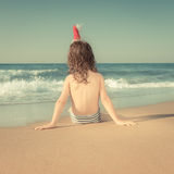 Child in Santa hat at the beach Royalty Free Stock Images