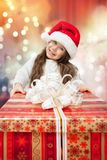 Child in Santa hat with gift box. Stock Image