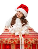 Child in Santa hat with gift box. Child in Santa hat with big red gift box Stock Photography