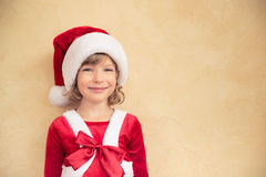 Child in Santa hat Stock Images