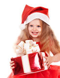 Child in santa hat holding gift box. Royalty Free Stock Photography