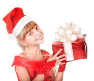 Child in santa hat holding red gift box. Stock Photos