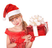 Child in santa hat holding red gift box. Stock Photo