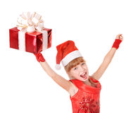 Child in santa hat holding red gift box. Stock Images