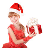 Child in santa hat holding red gift box. Royalty Free Stock Photo