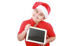 Child with Santa hat offering a tablet Stock Photo