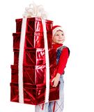 Child in Santa hat with stack gift box. Stock Images