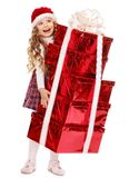 Child in Santa hat with stack gift box. Stock Photography