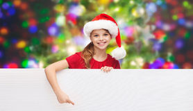 Child in santa helper hat with blank white board Royalty Free Stock Images