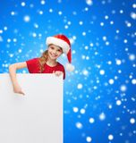 Child in santa helper hat with blank white board Royalty Free Stock Image