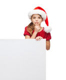 Child in santa helper hat with blank white board Royalty Free Stock Photos