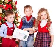 Child with Santa letter. Child with Santa letter near Christmas tree.Isolated Stock Photography