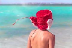 Child Santa sunbathing at exotic seaside stock photos