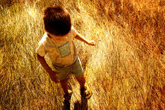 Child in savanna Stock Images
