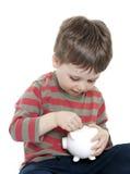 Child saving money Royalty Free Stock Photography