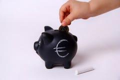 Child saving money Stock Images