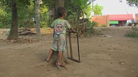 Child, saw, cambodia, southeast asia stock video footage