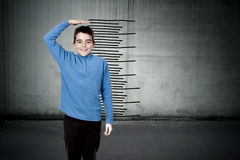 Child with the scale. Of growth Stock Photos
