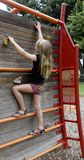 Child Scaling a Rock Climbing Wall. Royalty Free Stock Images