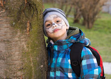 Child with scary face painting Stock Images