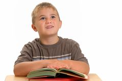 Child at school desk Stock Photo