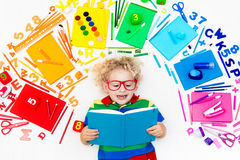 Child with school and drawing supplies. Student with book. Royalty Free Stock Photography