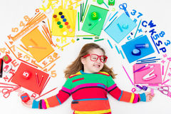Child with school and drawing supplies. Student with book. Royalty Free Stock Photos