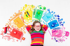 Child with school and drawing supplies. Student with book. Little girl with school supplies, books, drawing and painting tools and materials. Happy back to Stock Image