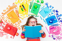 Child with school and drawing supplies. Student with book. Royalty Free Stock Image