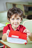 Child in school holding book Stock Photos