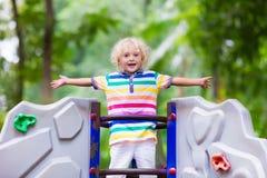 Child on school playground. Kids play. Stock Photo