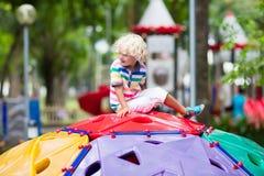 Child on school playground. Kids play. Stock Photos