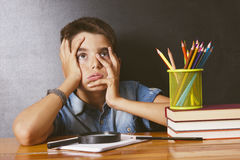 Child at school. Writing applied Stock Image