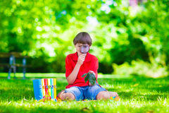 Child in school yard with magnifying glass Royalty Free Stock Photos