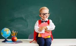 Child   schoolboy  boy student about school blackboard. The child   schoolboy  boy student about school blackboard stock photography