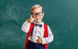 Child   schoolboy  boy student about school blackboard. The child   schoolboy  boy student about school blackboard stock image